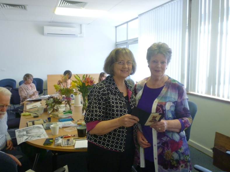 President of Marion Art Group Glenys Brokenshire (right) handing over the cheque to Parkinson's S.A CEO Christine Belford (left)